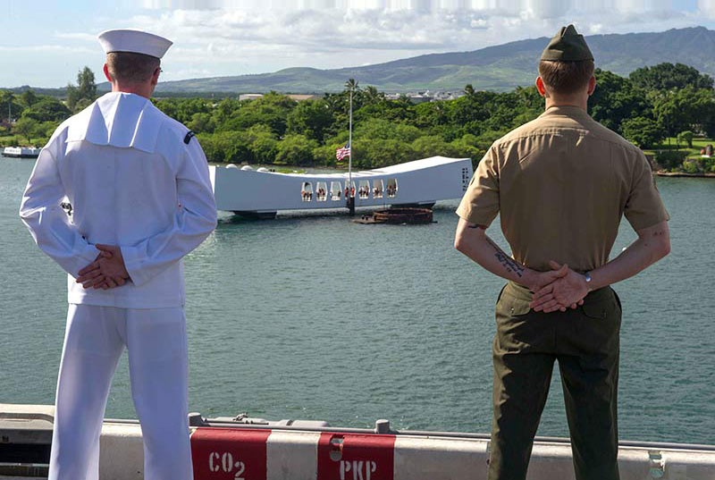 Ship passing by the Arizona Memorial