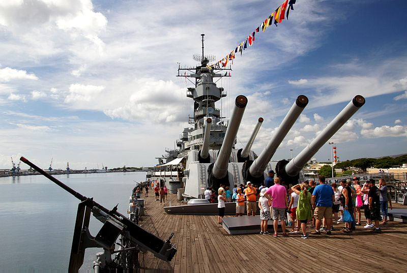 Stand next to the deck guns of the Battleship Missouri